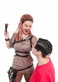 pic of makeup artist  - Professional makeup artist making makeup to a model isolated  on white - JPG