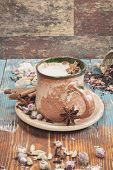 pic of spice  - Indian masala chai tea with spices and milk on rustic background - JPG