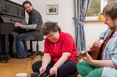 foto of disability  - a Music therapy with a mental disabled woman - JPG