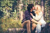 foto of swag  - Young Couple Man and Woman Kissing and Hugging in Love Romantic Outdoor with forest nature on background Travel Lifestyle - JPG