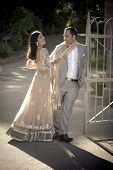 picture of flirt  - Young in love Indian couple flirting outdoors