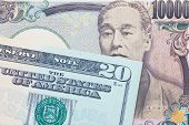 picture of currency  - Japanese yen currency and dollar bank note use for currency concept - JPG