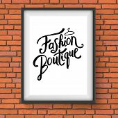 stock photo of boutique  - Close up Simple Text Style for Fashion Boutique Concept with Hanger Design on a Rectangular Frame Hanging on the Brick Wall - JPG