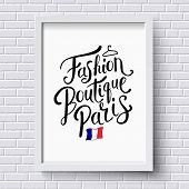 image of boutique  - Stylish Text for Fashion Boutique Paris Concept with Small French Flag on a White Frame Hanging on a White Brick Wall - JPG