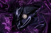 picture of bric-a-brac  - jewelry wristwatch on a black silk background - JPG