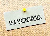 picture of paycheck  - Recycled paper note pinned on cork board - JPG