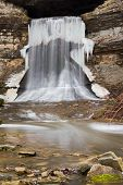 picture of porter  - A partially frozen waterfall plunges from the mouth of Indiana - JPG