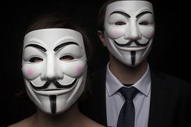 picture of freedom speech  - two members of anonymous activist hacker group with mask studio shot - JPG