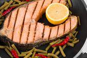 stock photo of salmon steak  - Fresh salmon steak on pan - JPG