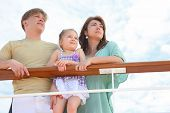 Family With Daughter Standing On Cruise Liner Deck Near Rail, Child Standing On Fence, Half Body