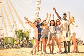 picture of ferris-wheel  - Group of multiracial happy friends cheering at ferris wheel  - JPG