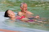 pic of hot couple  - Senior couple enjoying holiday in the pool with hot water - JPG
