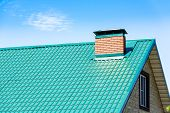 foto of roofs  - chimney on the roof of the house against the blue sky - JPG