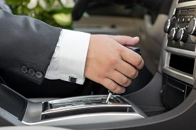 picture of designated driver  - Hand of the driver of the car  - JPG
