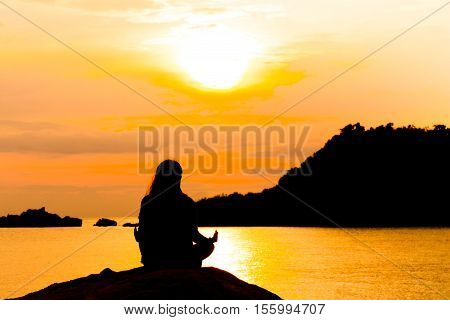 Silhouette Woman Meditating In Yoga
