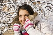 Smiling Positive Girl Among Winter Twigs