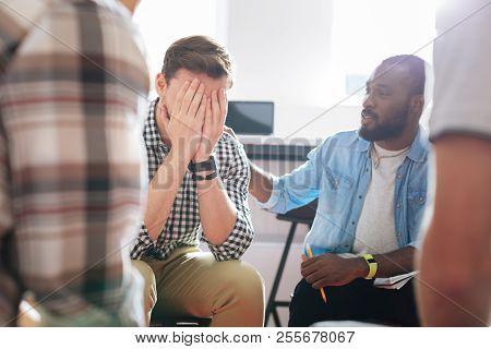 Unhappy Man Hiding His Face