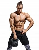 Young Man Doing Exercise With Kettlebell. Photo Of Athletic Man With Naked Torso And Good Physique O poster