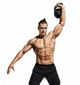 Sportive Guy Training With Kettlebell. Photo Of Handsome Man With Naked Torso And Good Physique On W poster