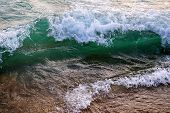 A Bright Green Wave Of Lake Michigan. Clear Water. White Foam On The Crest Of The Wave. The Wave Is  poster