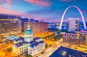 St. Louis, Missouri, USA downtown cityscape with the arch and courthouse at dusk. poster