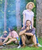 Find Companion To Travel And Hike. Friends Relaxing Near Campfire After Day Hiking Nature Background poster
