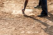 Referee Cleans Home Plate In A Baseball (softball) Dusty Field, With Copyspace poster