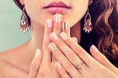 Beautiful Woman With Fresh Manicure And Makeup Wearing Jewellery. Beauty Fashion Model Showing Her N poster