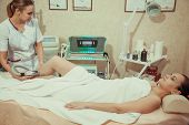 Hair Removal Cosmetology Procedure From A Therapist At Cosmetic Beauty Spa Clinic. Laser Epilation.  poster