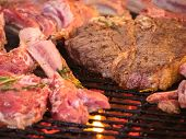 Grilled Steak. Ribs On Barbecue Grill. Cooking Delicious Juicy Meat Steaks On The Grill On Fire. Bbq poster