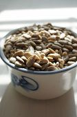 Many Sunflower Seeds For Cook, Sunflower Seeds In A Cup Gzhel,  Photophone, White Background, Purifi poster