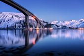 Bridge With Illumination, Snow Covered Mountains, Village And Blue Sky With Beautiful Reflection In  poster