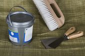 Trowels, A Wall Paper Brush And A Plastic Pail With Putty poster