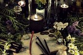 Still Life With Old Book, Antique Clock, Herbs, Black Candles And Ritual Objects. Mystic Background  poster