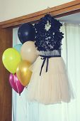 Prom Dress And Balloons With Helium Hanging. Selective Focus poster