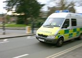 stock photo of infirmary  - ambulance going fast - JPG