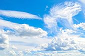 Blue Sky Background With White Dramatic Colorful Clouds And Sunlight. Sky Landscape Scene, Blue Sky  poster
