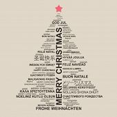 Christmas tree shape from letters - typographic composition - Merry Christmas in different languages