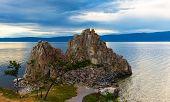 Awe Dusk Landscape With Shamanka Rock On Olkhon Island On Baikal Lake. Summer Vacation In The Heart  poster