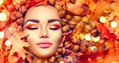 Autumn Woman makeup. Beautiful Autumn model girl face portrait with bright autumnal yellow, red and  poster