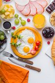 Homemade Breakfast With Sunny Side Up Fried Egg Toast Coffee Fruits Vegetable  And Orange Juice In T poster