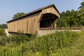Brown Wooden Covered Bridge - A Covered Bridge On A Rural Road. poster