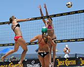 HERMOSA BEACH, CA - JULY 21: Michelle Moriarty, Morgan Beck and Kaitlin Sather compete in the Jose C