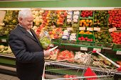 a senior shopping for food at the supermarket