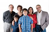 stock photo of east-indian  - An extended Indian family all pose together in a fun setting - JPG