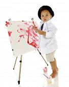 foto of french beret  - An adorable preschooler looking back at the viewer as he creates his own painted masterpiece - JPG