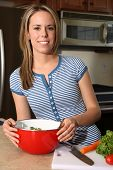 Young Attractive Girl Cooking poster