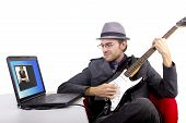 stock photo of serenade  - male serenading woman via webcam internet call - JPG