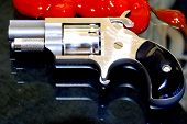 stock photo of derringer pistol  - Pretty but deadly this five shot .22 caliber Ladies revolver measure just 3 1/2 Inches!