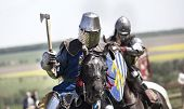 image of jousting  - Medieval knights in battle background with horse - JPG